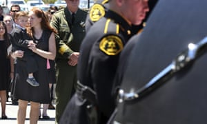 Faviola Del Real holds her son, Carter, as the coffin of her husband, Damon Gutzwiller, is loaded into a hearse following a memorial on 17 June 2020, in Santa Cruz.