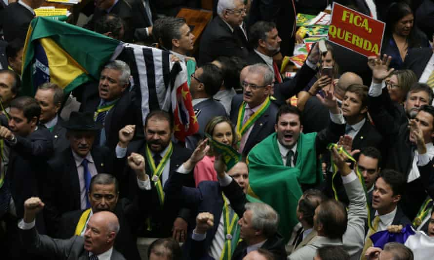 Opposition deputies celebrate the start of the voting during the session on Brazilian president Dilma Rousseff's impeachment.