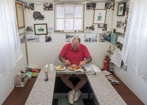 A taxi driver eats breakfast