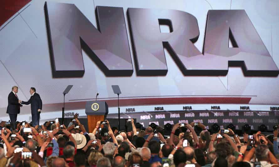 Donald Trump, left, shakes hands with the NRA chief executive, Wayne LaPierre