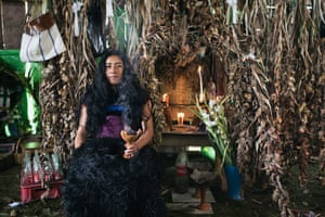 A woman in front of an altar at her home in El Pinar