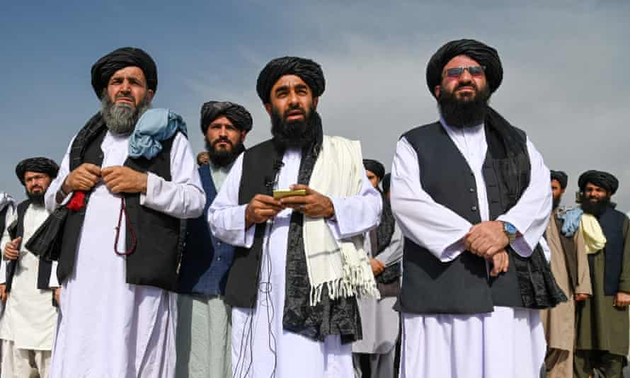 Taliban spokesman Zabihullah Mujahid speaks to the media at the airport in Kabul on 31 August after the US had pulled all its troops out of the country