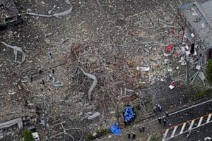 Investigators work at the site of an explosion in Fukushima prefecture in Kōriyama, Japan
