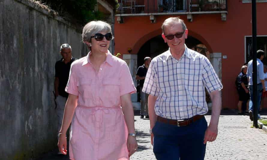 Theresa May in a pink dress, in Italy with her husband Philip