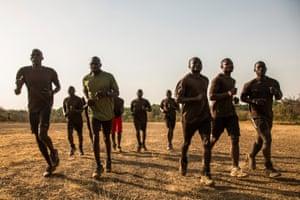 Rangers go on a morning jog down the main airstrip.