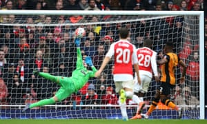 Hull City's Eldin Jakupovic saves a shot from Danny Welbeck of Arsenal in the FA Cup