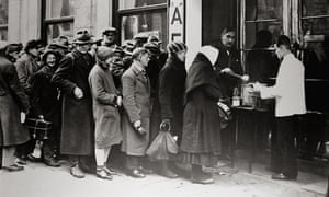 Poverty-struck Vienna residents queue for soup in 1920.