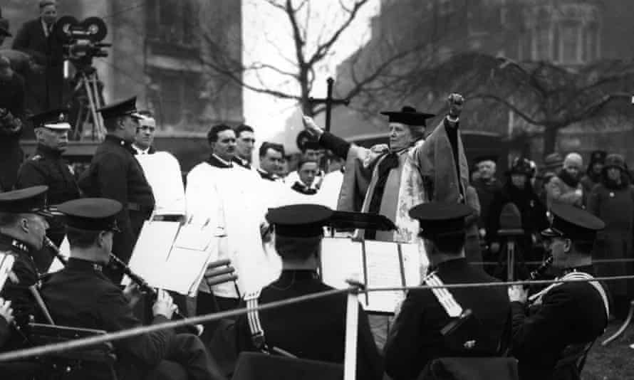 Dame Ethel Smyth conducts the Police Band in 1930 during the ceremony to unveil the Pankhurst Statue in Victoria Tower Gardens, London