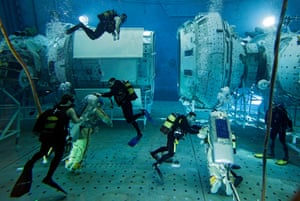 Trainees in spacesuits assisted by scuba divers in a pool of the Russian cosmonauts training centre at Star City outside of Moscow.