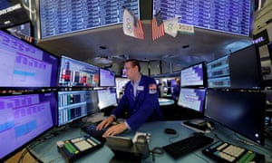 A trader works at the New York Stock Exchange (NYSE) last month
