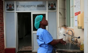 A health worker washes her hands during a demonstration of preparations for any potential coronavirus cases at a hospital in Harare, Zimbabwe, March 11, 2020.