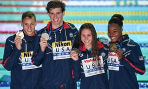 Caeleb Dressel (left) and Simone Manuel (right) pose with Zach Apple (second left) and Mallo Comerford after the mixed 4x100m freestyle relay