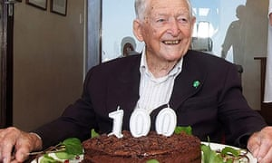 Mike Hoare pictured in March 2019 with birthday cake and '100' candles