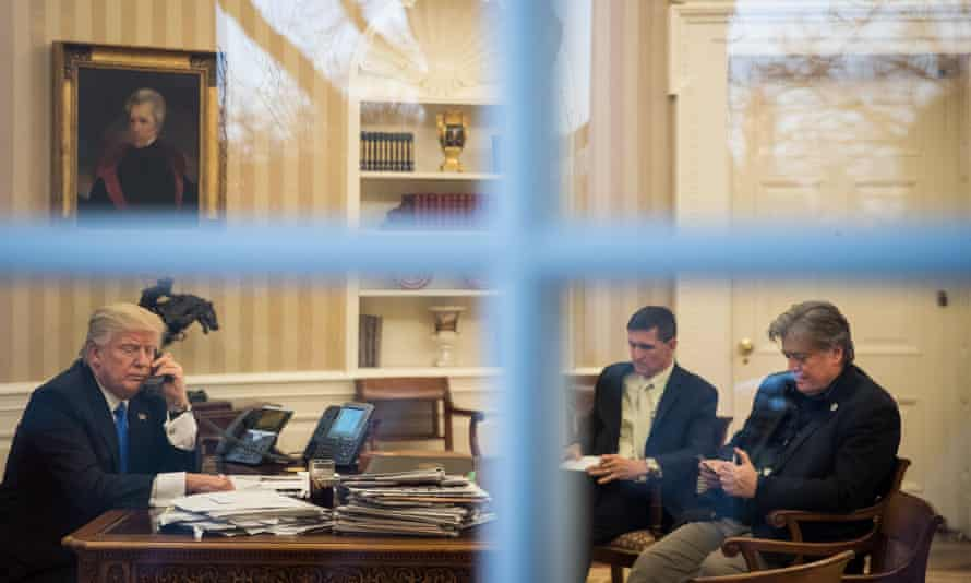 The White House chief strategist, Steve Bannon, far right, sits alongside the national security adviser, Michael Flynn, in the Oval Office with President Donald Trump.