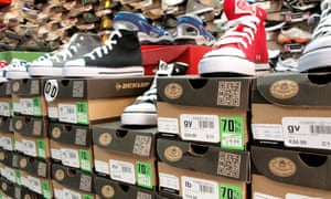 Display of trainers on sale at a Sports Direct shop in Cirencester.