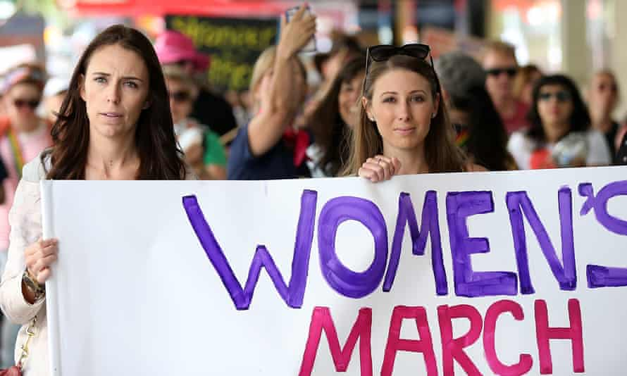 Jacinda Ardern (left) on the women's march in Auckland.