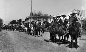Mexican caballeros line up in 1903 for La Fiesta de Los Angeles, a celebration of the city's many cultures.
