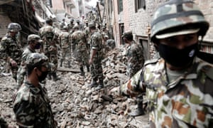 A team of soldiers clearing rubble from a destroyed structure as they continue with search and recovery operations near Bhaktapur