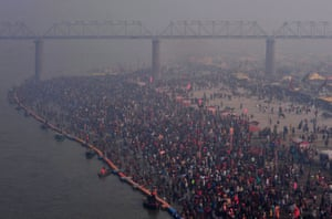 Prayagraj, India. Hindus gather to take a holy dip in the waters of Sangam, the confluence of the Ganges, Yamuna and Saraswati rivers, to mark Mauni Amavasya, the most auspicious day during the annual religious festival of Magh Mela