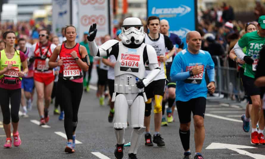 A runner dressed as a stormtrooper from Star Wars runs in the marathon.