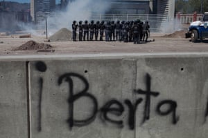 Riot police in front of the National University of Honduras use teargas on students protesting