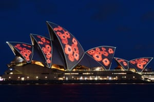 The Sydney Opera House illuminated with red poppies to commemorate Remembrance Day