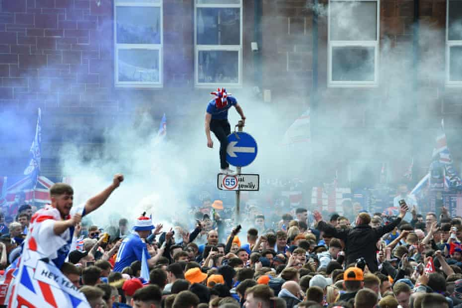 Rangers fans celebrate outside Ibrox Stadium after the team lifted the Scottish Premiership trophy for the first time in 10 years