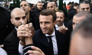 Emmanuel Macron meets with youth during a campaign visit to Sarcelles, north of Paris, on Thursday.