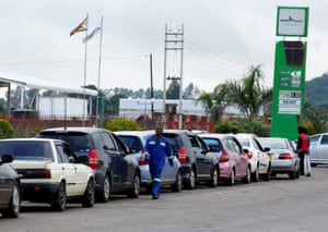 Motorists queue for fuel in Harare.