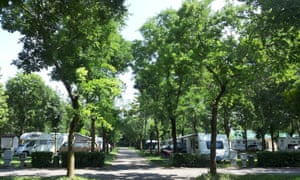 Camping  Milano with caravans under trees