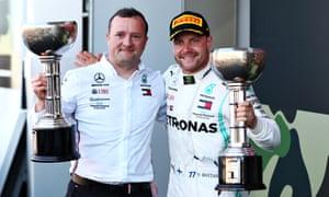 Valtteri Bottas (right) celebrates his race victory and Mercedes' constructors' championship at Suzuka Circuit.