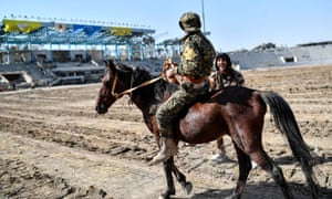 An SDF fighter rides a horse at the stadium