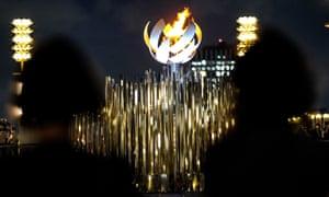 Olympic flame burning on the cauldron at Ariake Yume-no-Ohashi Bridge