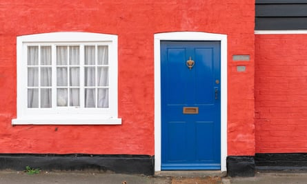 A brightly coloured cottage in a UK village