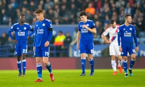 Leicester City players look dejected after conceding their fourth goal in stoppage time.