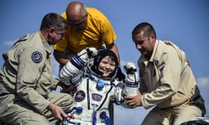 The Nasa astronaut Anne McClain helped out of the Soyuz MS-11 capsule shortly after landing in a remote area of Kazakhstan in June