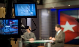Reporter Amado Gil, right, tapes a segment with guest Alexis Jardines at the TV Martí studio in Miami on 9 March 2015.
