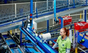 A worker at Ocado's highly automated warehouse in Hatfield, Hertfordshire, UK.