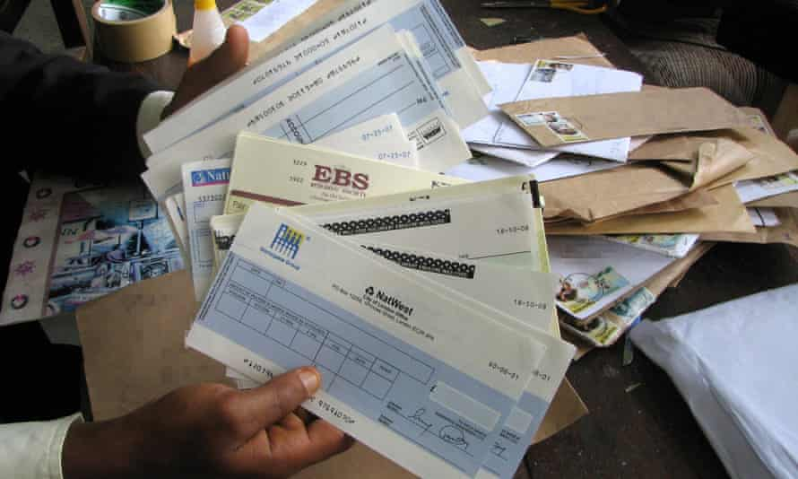 Serious Organised Crime Agency officials with false documents found during an investigation of marketing fraud in Nigeria