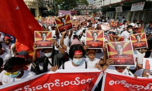 Demonstrators hold placards calling for the release of detained civilian leader Aung San Suu Kyi during a protest against the Myanmar military coup, in Yangon,