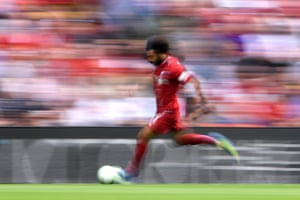 Mohamed Salah of Liverpool runs with the ball on his way to scoring the first as Liverpool thrash West Ham 4-0 at Anfield.