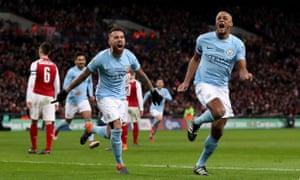 Vincent Kompany celebrates with Nicolás Otamendi after the Belgian defender scored Manchester City's second goal.