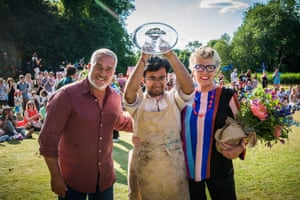 2018 Bake Off winner Rahul Mandal with judges  Paul Hollywood and Prue Leith.