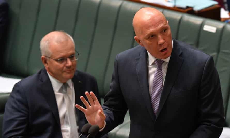 Australian prime minister Scott Morrison watches on as Peter Dutton speaks in parliament