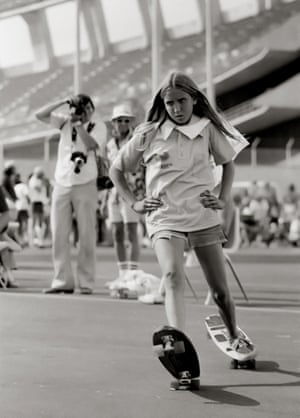 Laura Thornhill riding two boards at the Del Mar Racetrack in San Diego County, 1975