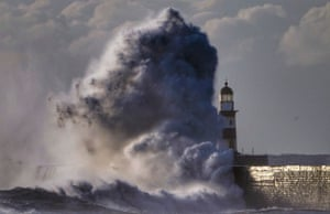 Durham, UK. Waves crash over the walls next to Seaham lighthouse in Durham