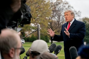 Donald Trump speaks to members of the media on the South Lawn of the White House in Washington on 26 November 2018.