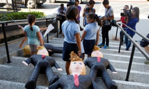 US-born children of immigrants drag Donald Trump pinatas down stairs. This week, a top Republican senator has joined forces with a Democrat senator to urge President Trump to grant legal status and a path to citizenship to undocumented immigrants if they are longtime residents of the US.