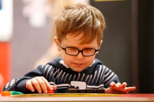 Five-year-old Parker Thorne plays with Lego bricks