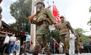 Men wearing Japanese imperial military uniform visit the Yasukuni Shrine in Tokyo, on the 74th anniversary of Japan's surrender in the second world war.